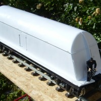 Borden's milk tank car - white; brake wheel end