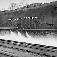 Scooping water from track pans on the New York Central