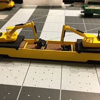 Well car with two 245G LC Excavator with load of railroad ties