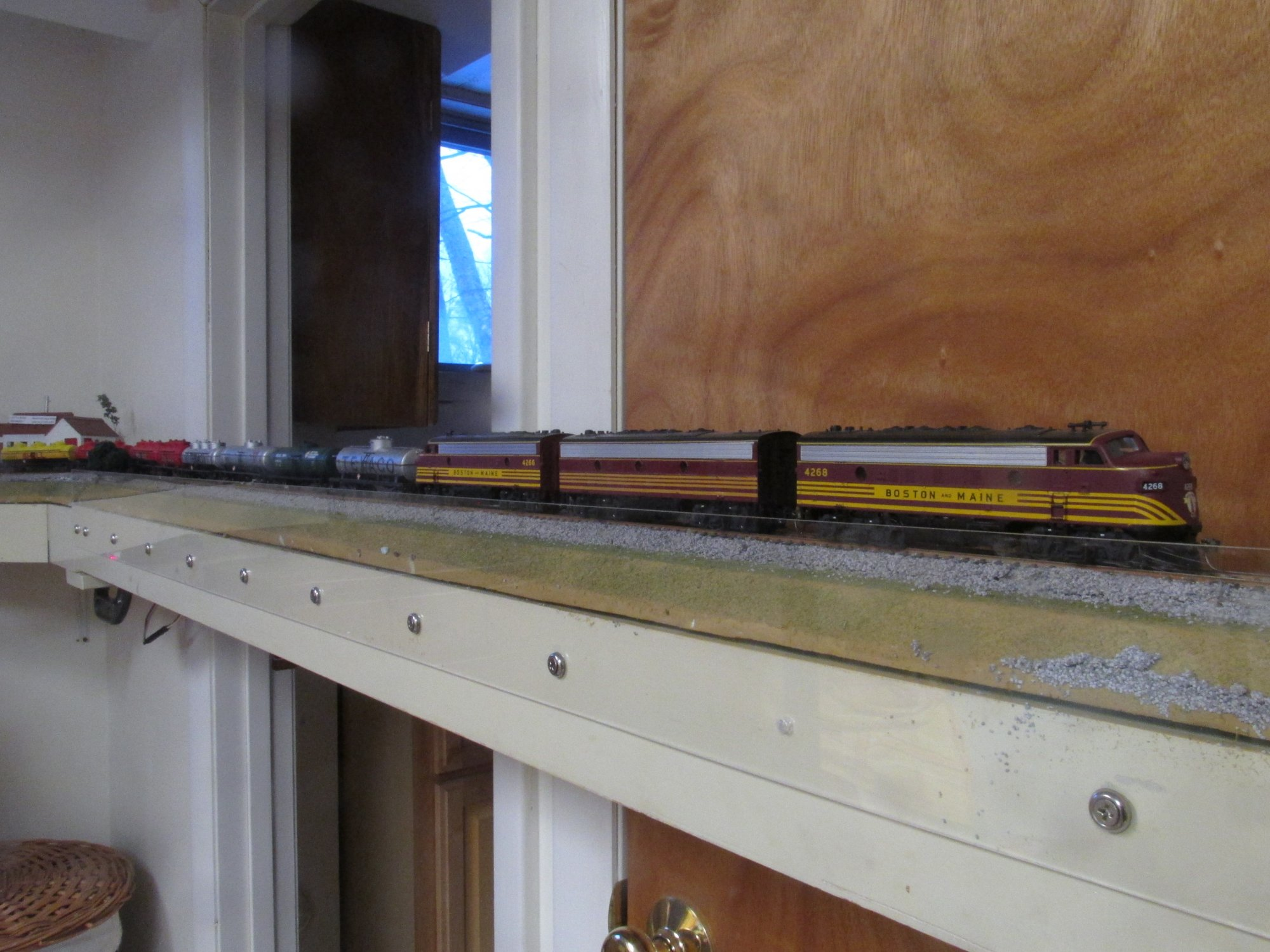 Athearn F7 ABA lashup on point of unit tank car train on the bathroom straight